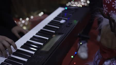 Hands play on the Synthesizer at Christmas