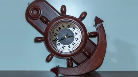 Timelapse of the clock in the shape of an anchor and a ships helm