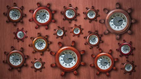 Many clocks in the shape of a ships helm