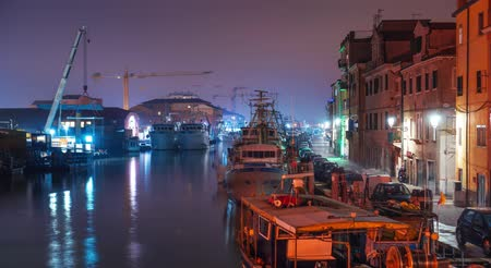 Night timelapse of the port of the fishing boats of Chioggia 動画素材