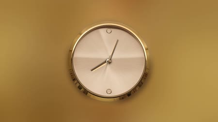 Gold watch in timelapse on a yellow background