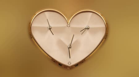 dia : Clock in the shape of a heart in timelapse Vídeos