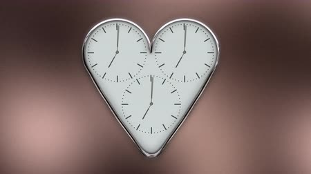 Clock in the shape of a heart in timelapse 動画素材