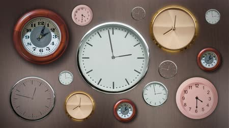 Timelapse of many wall clocks 動画素材
