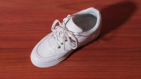 White shoe ties shoelaces in stop motion 動画素材