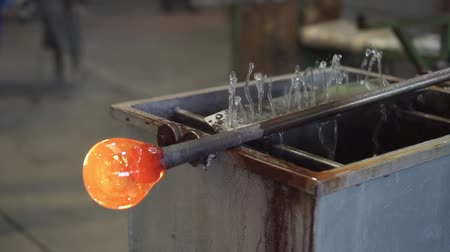 hot rod : Blown glass ball is cooled in the factory