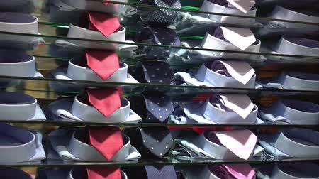 для продажи : Shirts with ties for sale in the shop Стоковые видеозаписи