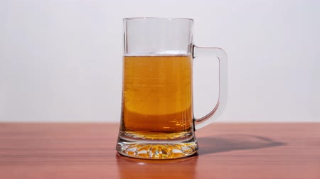 pint glass : Beer pours itself into the mug Stock Footage