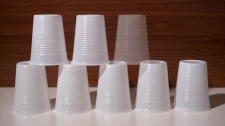 глыба : Plastic cups appear in stop motion in the shape of a pyramid Стоковые видеозаписи