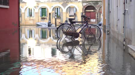 habitable : Bicycles on the flooded city street Stock Footage