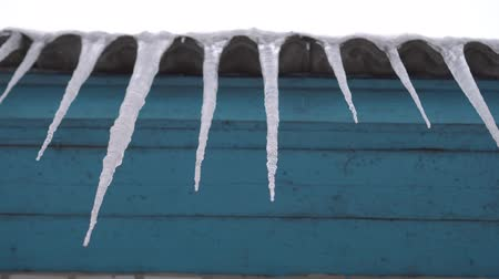 sincelo : Huge icicles descend from the roof Stock Footage