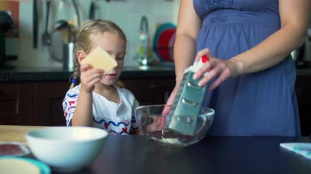 baking dishes : Little Girl Grating Cheese with Mother