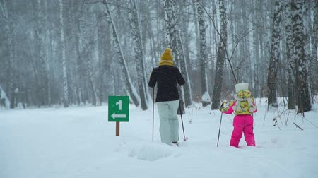 kilometer : Woman and Girl Skied One Kilometer
