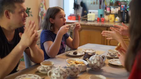 drink tea : Family Drinking Tea and Talking in the Kitchen Stock Footage