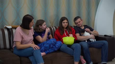 терьер : Family Watching TV on the Sofa with the Dog