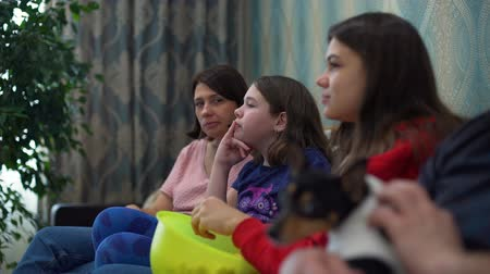 sitting room : Family Watching TV on the Sofa Stock Footage