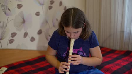 gravador : Girl Practicing Flute at Home