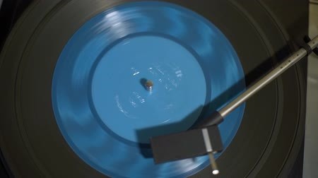 tonearm : Vintage Turntable with Spining Blue Vinyl Record