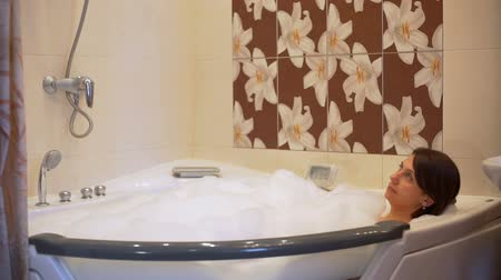 foam bath : Woman Relaxing in Bubble Bath in Bathtub