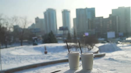 káva : Two Cups of Coffee on a Snow and Winter City