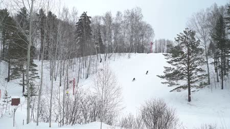 sporty zimowe : People Riding Downhill near the Small Ski Lift Wideo