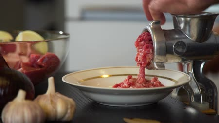 ground meat : Elderly Man Twisting Meat in the Meat Grinder