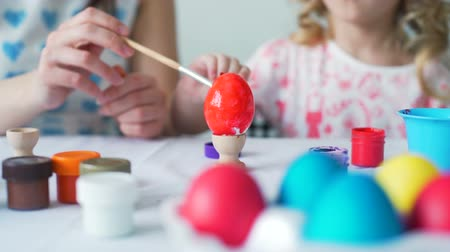 rabbit ears : Little Girl and Her Mother Painting Eggs for Easter Stock Footage