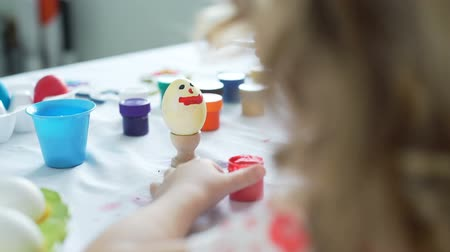 easter : Little Girl Having Fun to Paint Easter Eggs Stock Footage