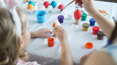 easter : Painting with Brushes on Easter Egg