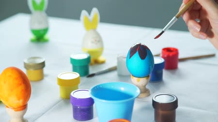 rabbit ears : Woman Hand Decorating Easter Egg Stock Footage