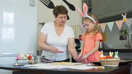 easter : Girl with her Grandma Baking Cookies on Easter