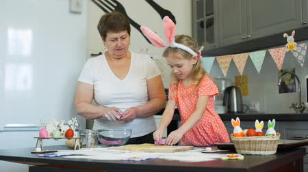 easter : Grandma and Granddaughter Baking Easter Cookies