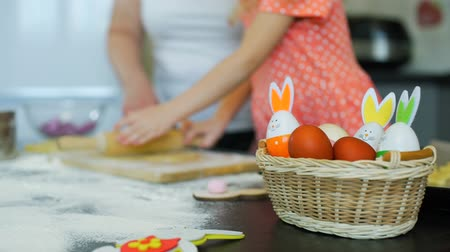 easter : Grandma Teaching Little Girl Rolling Out a Dough Stock Footage