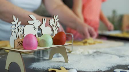 easter : Little Girl and Grandma Cutting Easter Cookies Stock Footage