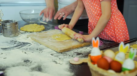 easter : Little Girl and Grandma Rolling Out a Dough