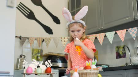 rabbits : Little Girl Decorating Cookies and Tasting Cream Stock Footage