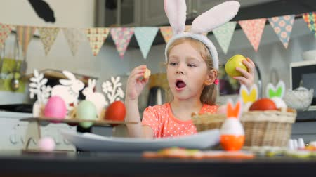 rabbits : Little Girl Eating Easter Cookies and Apple