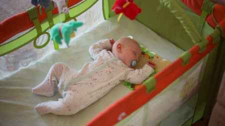 emzik : Panning Camera on Little Baby Sleeping in a Crib
