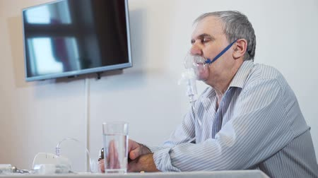 alergia : Senior Man Taking Aerosols Inhalation Stock Footage