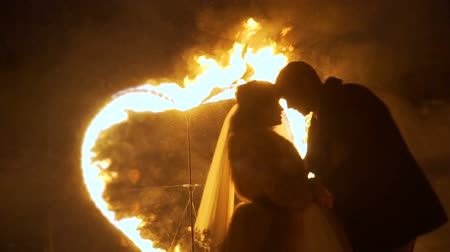 örök : Newlyweds with Burning Heart on the Background
