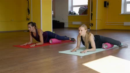 pilates : Women Using Foam Rollers in Rehabilitation Centre