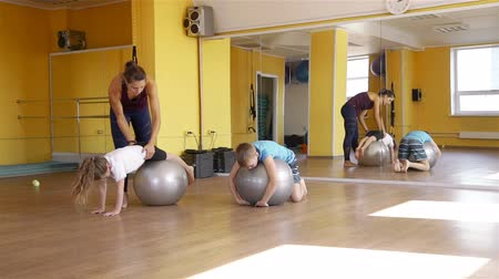 pilates : Children Doing Exercises with Fit Balls in a Gym