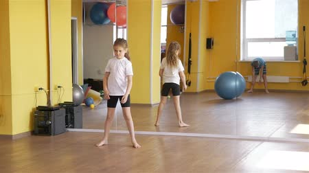 jimnastik : Children Rolling Fitness Ball Each Other in a Gym