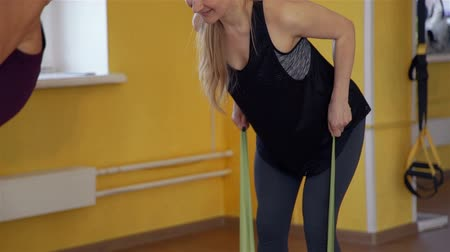 pulling rope : Woman Pulling an Elastic band in Physiotherapy