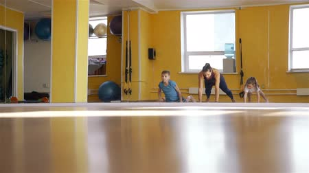 pilates : Children Exercising with Physical Therapist Stock Footage