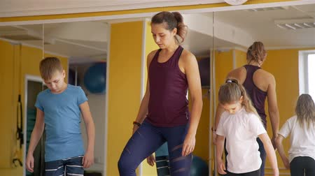 aerobic : Physiotherapist working with Children Patients. They Working Out in a Rehabilitation Center. Rehabilitation after Trauma Concept