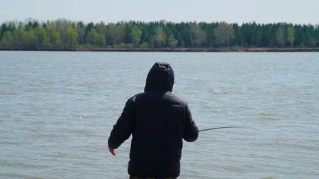 tyč : Senior Man Casting a Fishing Rod on a River Bank. Fishing in a River. The Concept of Quiet Outdoor Recreation. Slow Motion