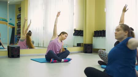obesity : Overweight Women Doing Gymnastics at the Fitness Studio with Personal Trainer. Workout of Plump Women on Mats. Healthcare, Sport, Fitness, Weight Losing, Active Lifestyle Concept