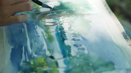 talento : Painting with Brush and Watercolor in Slow Motion. Close Up. Professional Painter Drawing a City Embankment. Creativity Inspiration Expression Concept