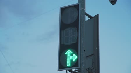 stoplight : Traffic Light Changing Red Light to Green in the Evening. Close Up. Transportation and Sign Concept
